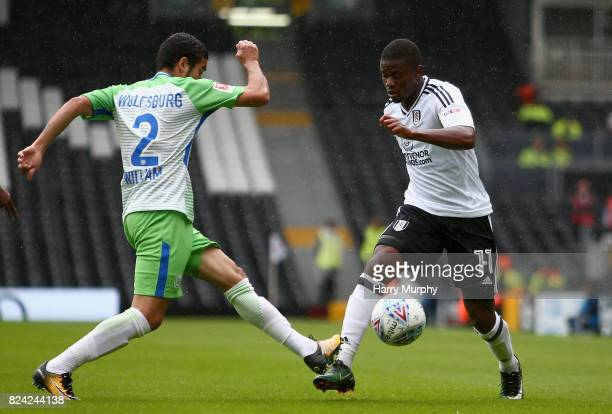 William of Vfl Wolfsburg and Floyd Ayite of Fulham battle for possession during the PreSeason Friendly match between Fulham and VfL Wolfsburg at...