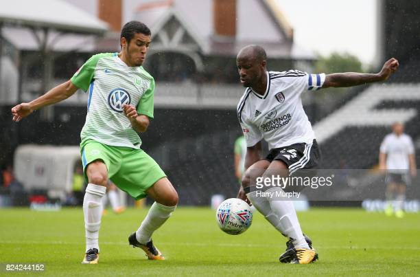 William of Vfl Wolfsburg and Sone Aluko of Fulham battle for possession during the PreSeason Friendly match between Fulham and VfL Wolfsburg at...