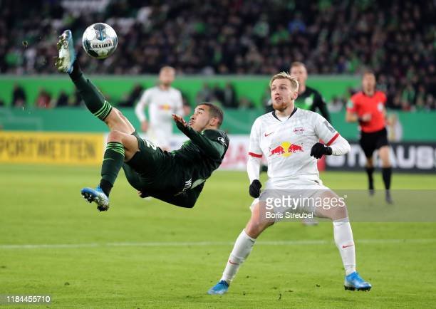 William of VfL Wolfsburg attempts a overhead kick as Emil Forsberg of RB Leipzig reacts during the DFB Cup second round match between VfL Wolfsburg...