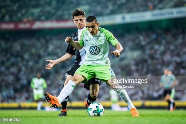 William of Wolfsburg and Jonas Hofmann of Moenchengladbach in action during the Bundesliga match between Borussia Moenchengladbach and VfL Wolfsburg...