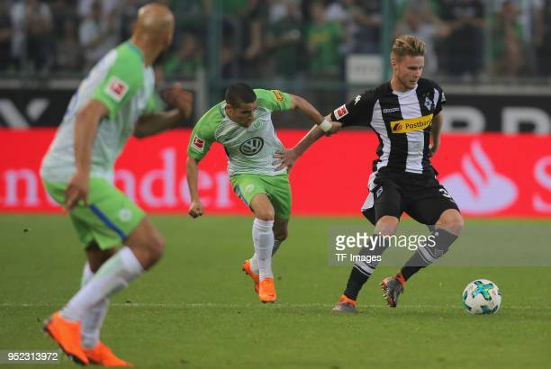 William of Wolfsburg and Nico Elvedi of Moenchengladbach battle for the ball during the Bundesliga match between Borussia Moenchengladbach and VfL...