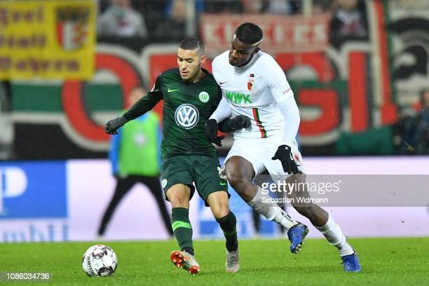 William of Wolfsburg and Sergio Cordova of Augsburg compete for the ball during the Bundesliga match between FC Augsburg and VfL Wolfsburg at...