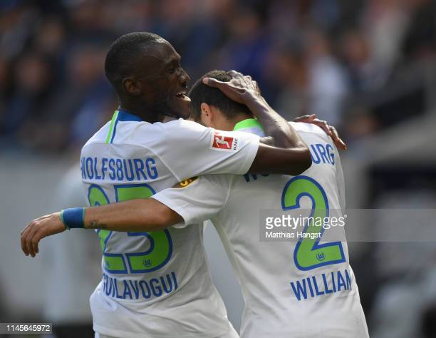 William of Wolfsburg celebrates scoring his team's first goal with Josuha Guilavogui during the Bundesliga match between TSG 1899 Hoffenheim and VfL...