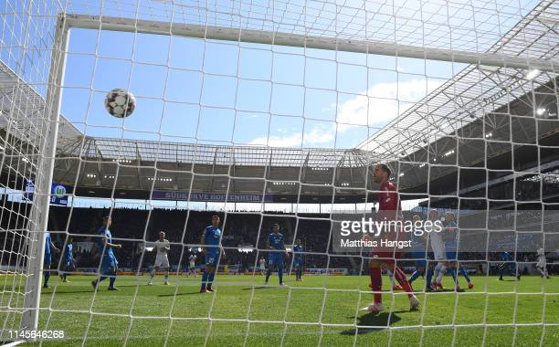 William of Wolfsburg scores his team's first goal as goalkeeper v of Hoffenheim watches the ball go into the net during the Bundesliga match between...