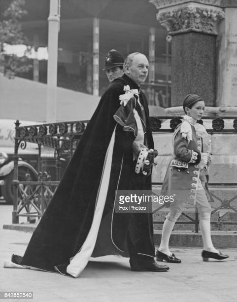 William OrmsbyGore 4th Baron Harlech the Standard Bearer for the Principality of Wales arrives at Westminster Abbey with his page Julian OrmsbyGore...
