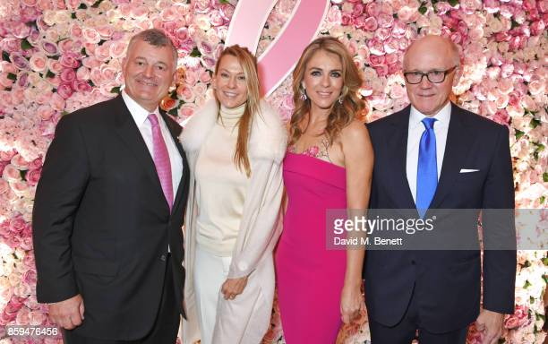 William P Lauder Executive Chariman of The Estee Lauder Companies Suzanne Johnson Elizabeth Hurley and Ambassador Robert W Johnson US Ambassador to...