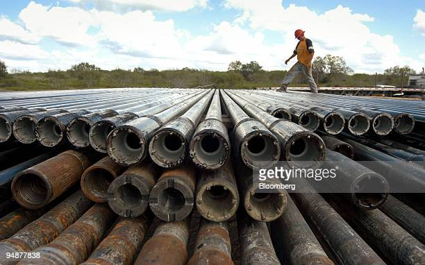 William Park, a member of the wildcat team from Paterson-UTI Drilling Company, helps unload casing pipe on October 1, 2004 in George West, Texas. He...