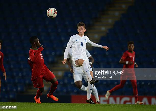 William Patching of England is challenged by Moreto of Portugal during the Under 17 International match between England U17 and Portugal U17 at...