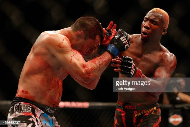 William Patolino punches Bobby Voelker in their welterweight bout during the UFC 168 event at the MGM Grand Garden Arena on December 28, 2013 in Las...