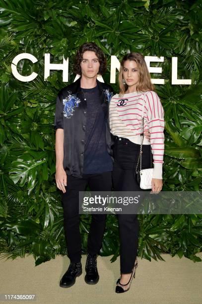 William Peltz and Kenya KinskiJones attend Chanel Dinner Celebrating Gabrielle Chanel Essence With Margot Robbie on September 12 2019 in Los Angeles...