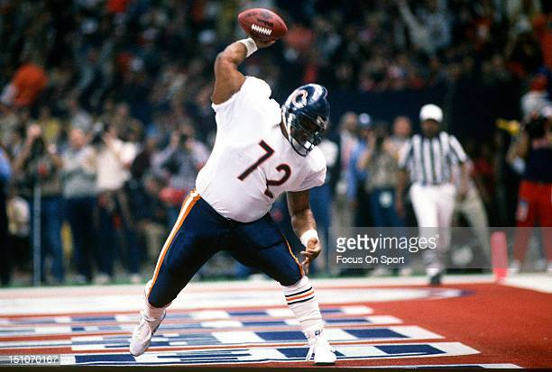 William Perry celebrates after scoring a touchdown against the New England Patriots during Superbowl XX at the Louisiana Superdome January 26 1986 in...