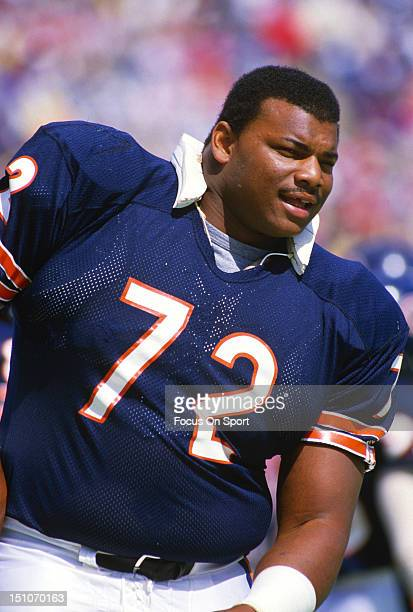 William Perry of the Chicago Bears looks on from the sidelines during an NFL football game at Soldier Field circa 1985 in Chicago Illinois Perry...