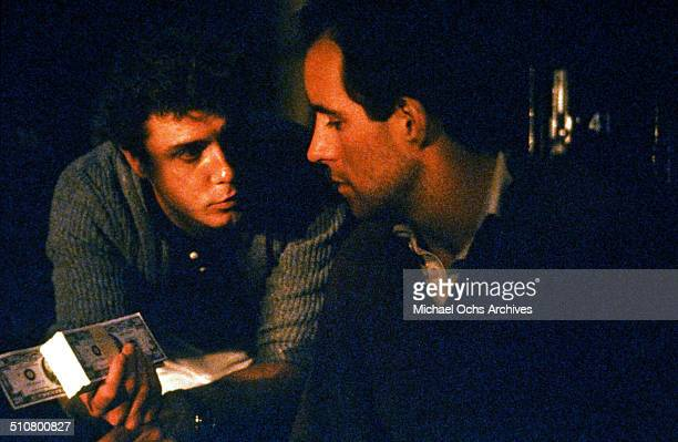 William Petersen and John Pankow talk about money in a scene from the MGM movie 'To Live and Die in LA' circa 1985