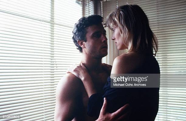 William Petersen holds Debra Feuer in a scene from the MGM movie 'To Live and Die in LA' circa 1985