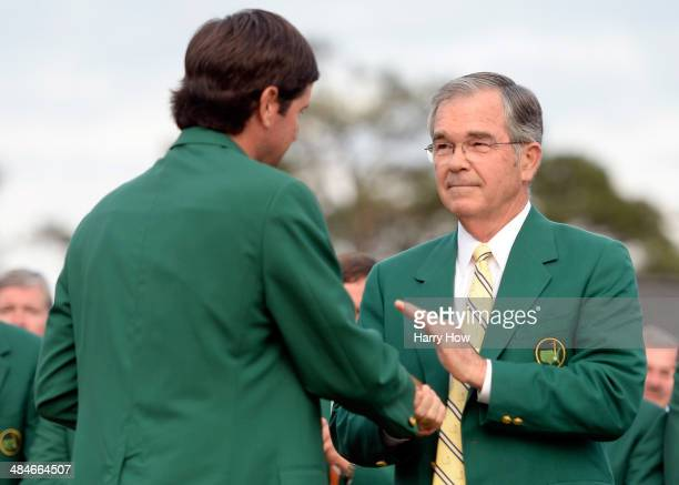 William Porter Payne chairman of Augusta National Golf Club shakes hands with Bubba Watson of the United States after Watson won the 2014 Masters...