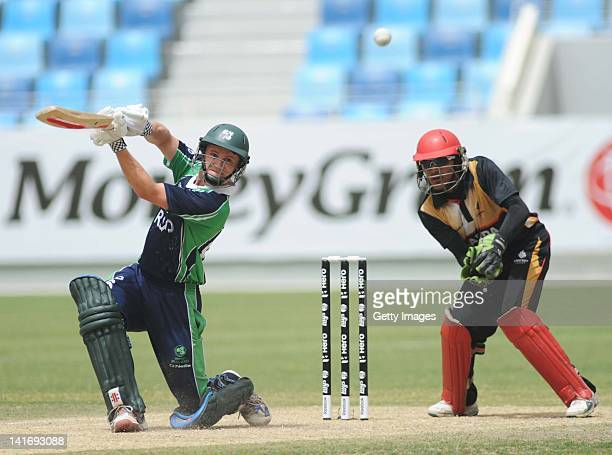 William Porterfield Captain of Ireland hits out for four during the ICC World Twenty20 Qualifier Semi Final between Ireland and Canada at the Dubai...