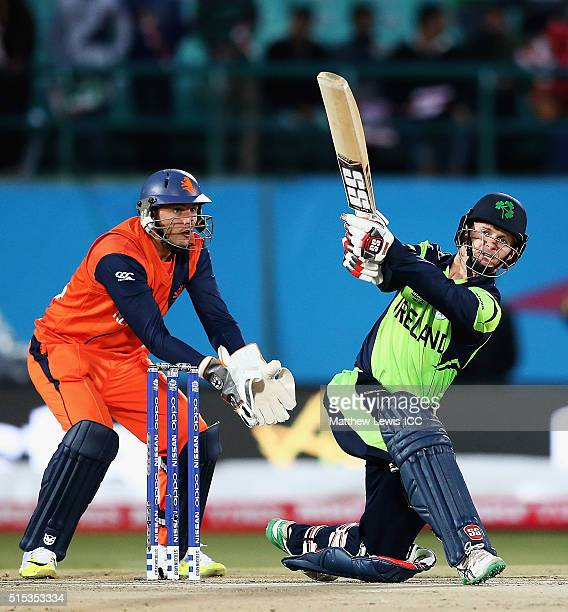 William Porterfield Captain of Ireland hits the ball towards the boundary as Wesley Barresi of the Netherlands looks on during the ICC World Twenty20...
