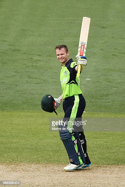 William Porterfield of Ireland celebrates reaching 100 runs during the 2015 ICC Cricket World Cup match between Pakistan and Ireland at Adelaide Oval...