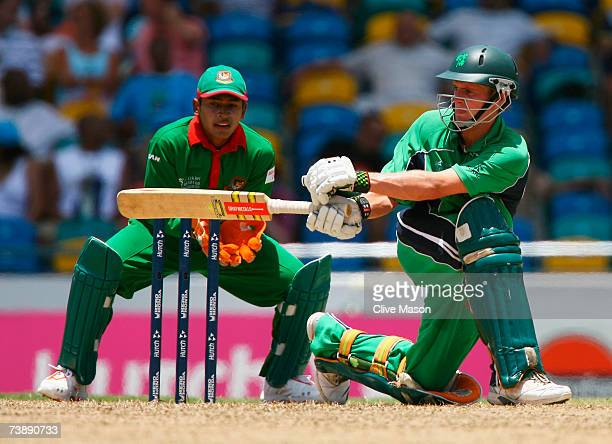 William Porterfield of Ireland hits out as wicketkeeper Mushfiqur Rahim of Bangladesh looks on during the ICC Cricket World Cup Super Eights match...