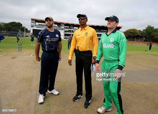 William Porterfield of Ireland Kyle Coetzer of Scotland and Umpire Gregory Braithwaite toss a coin ahead of the ICC Cricket World Cup Qualifier Warm...