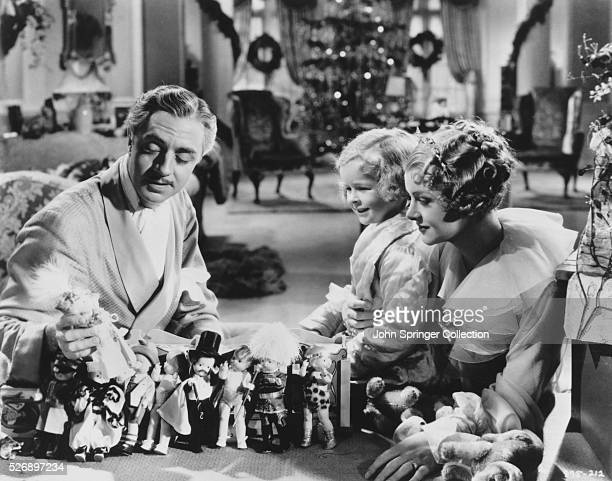 William Powell as Florenz Ziegfeld Jr Myrna Loy as Betty Burke and Joan Holland as their daughter Patricia in the 1936 film The Great Ziegfeld
