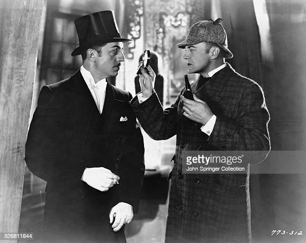 William Powell as Foreman Wells and John Barrymore as Sherlock Holmes in the 1922 silent film Sherlock Holmes