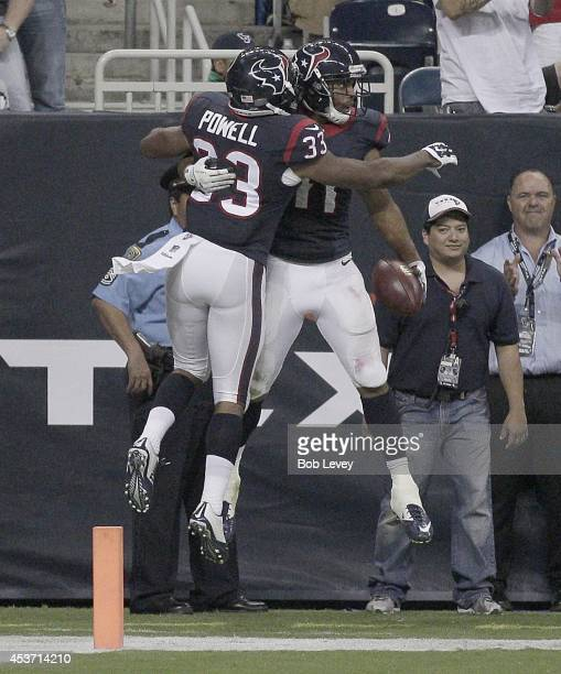 William Powell of the Houston Texans celebrates with DeVier Posey of the Houston Texans punt return from a touchdown in the fourth quarter in a...