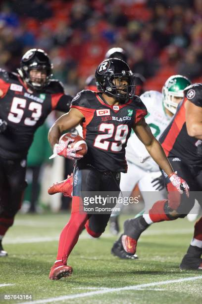 William Powell of the Ottawa Redblacks runs the ball against the Saskatchewan Roughriders to set up a touchdown The Saskatchewan Rough Riders...