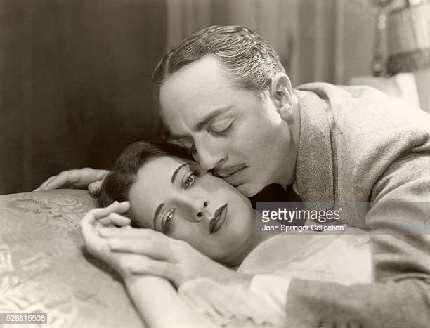 William Powell romances Kay Francis in a scene from the 1932 drama One Way Passage