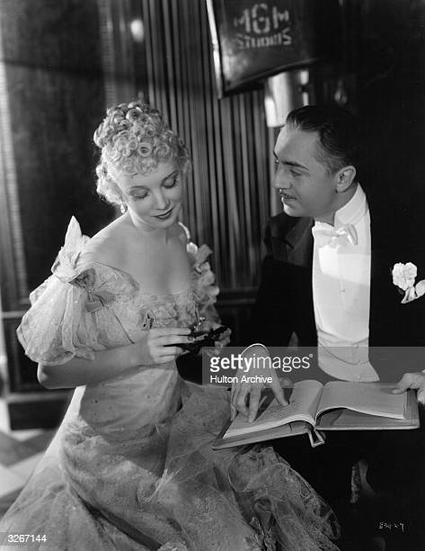William Powell the American leading man and Virginia Bruce formerly Helen Virginia Briggs as they study lines between scenes in 'Masquerade' at the...