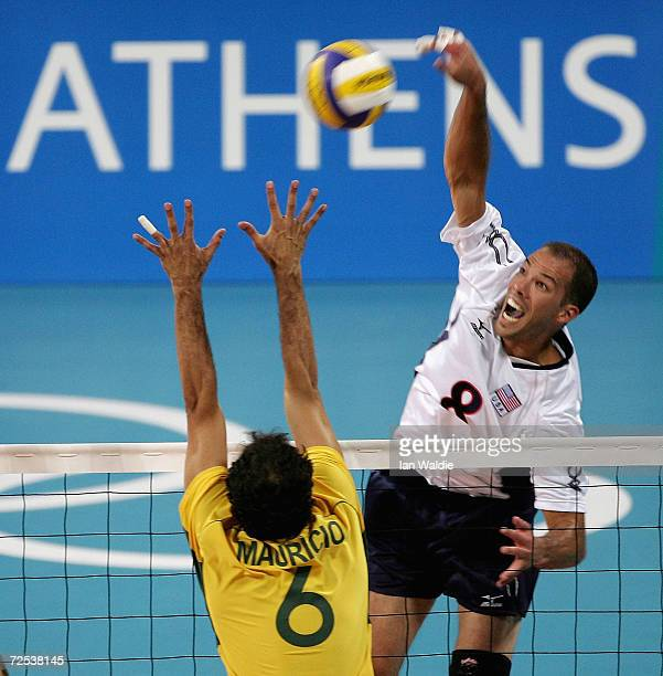 William Priddy of the USA spikes the ball past Mauricio Lima of Brazil in the men's indoor Volleyball preliminary match on August 23 2004 during the...