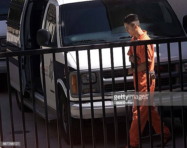 William R Skidmore 20 of Simi Valley walks toward a Santa Barbara Sheriff's prisoner transport van Friday Aug 18 after a court appearance in...
