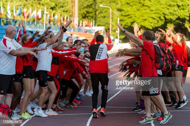 William Reais of Switzerland celebrate his gold medal with team Switzerland after Men's 200m Final during 2021 European Athletics U23 Championships -...
