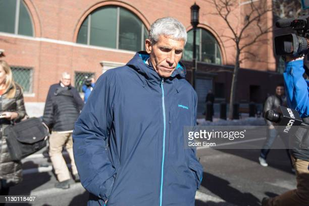 William Rick Singer leaves Boston Federal Court after being charged with racketeering conspiracy money laundering conspiracy conspiracy to defraud...