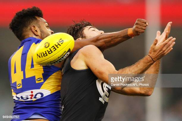 William Rioli of the Eagles and Kade Simpson of the Blues contest the ball during the round five AFL match between the Carlton Blues and the West...