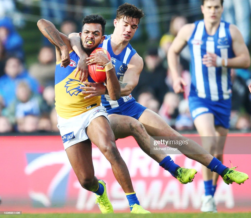 William Rioli of the Eagles is tackled high by Jy Simkin of the Kangaroos but received no free kick during the round 19 AFL match between the North Melbourne Kangaroos and the West Coast Eagles at Blundstone Arena on July 29, 2018 in Hobart, Australia.