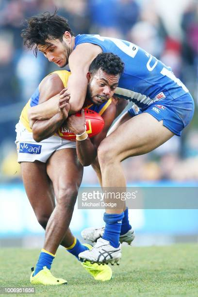 William Rioli of the Eagles is tackled high by Robbie Tarrant of the Kangaroos during the round 19 AFL match between the North Melbourne Kangaroos...