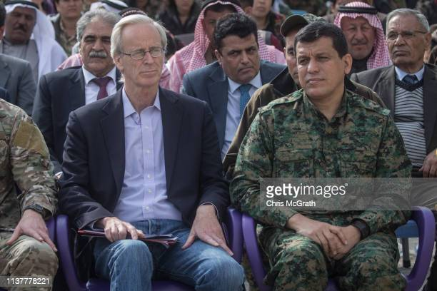 William Roebuck, advisor for the US Department of State in northern Syria and Syrian Democratic Force's commander in chief Mazloum Kobani look on...