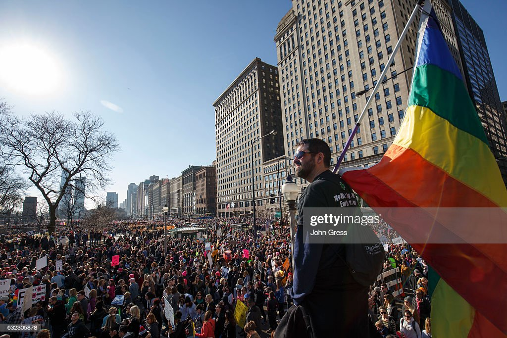 William Rosen looks over protesters as they participate in the Women's March on January 21, 2017 in Chicago, Illinois. Tens of thousands of demonstrators took to the streets in protest after the inauguration of President Donald Trump.