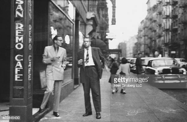 William S. Burroughs and Alan Ansen chat on the sidewalk outside the San Remo Cafe in Greenwich Village.
