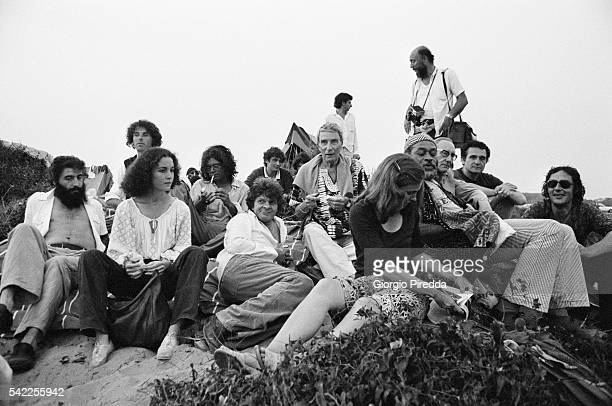 William S Burroughs Brion Gysin and John Giorno surrounded by friends on the seashore of Castel Porziano during the Festival Internazionale dei Poeti