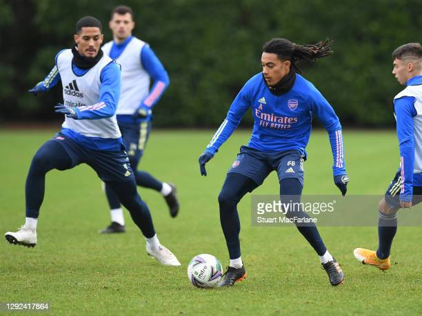William Saliba and Miguel Azeez of Arsenal during a training session at London Colney on December 21, 2020 in St Albans, England.