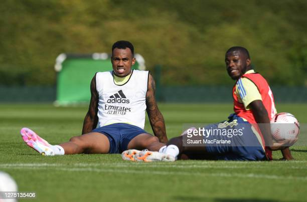 William Saliba and Nicolas Pepe of Arsenal during a training session at London Colney on September 22 2020 in St Albans England