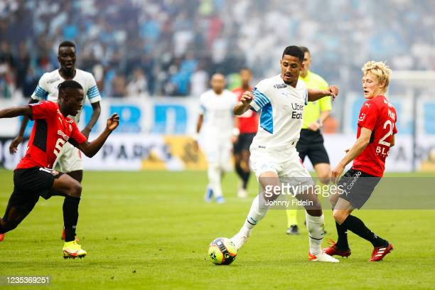 William SALIBA of Marseille and Birger MELING of Rennes during the Ligue 1 Uber Eats match between Marseille and Rennes at Orange Velodrome on...