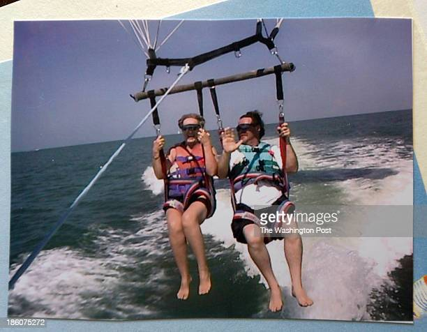 William Scott right a former patient of Dr Federico Vinas of Daytona Beach hangs with wife Marilyn from a parasail in Tampa in this family photo...