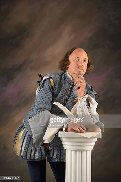 William Shakespeare in period clothing leaning on column with hand to chin in thoughtful expression