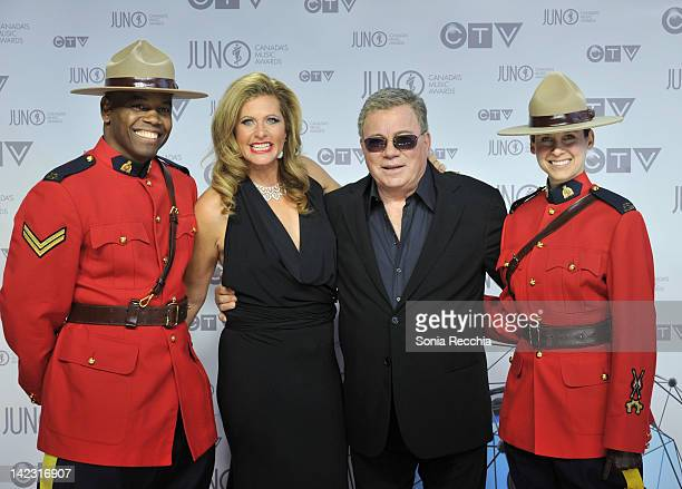 William Shatner and his wife Elizabeth Shatner pose on the red carpet at Scotiabank Place on April 1 2012 in Ottawa Canada