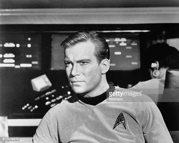William Shatner as Captain James Kirk with a look of concern in close up of him seated in the Starship Enterprise during an episode of Star Trek
