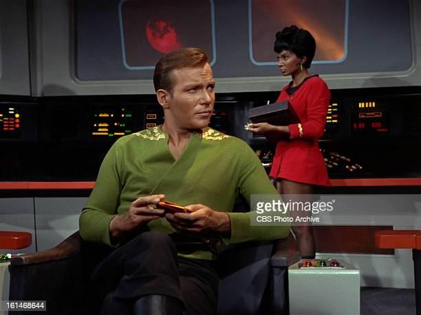 "William Shatner as Captain James T. Kirk and Nichelle Nichols as Lieutenant Uhura in the STAR TREK episode, ""Charlie X."" Season 1, episode, 2...."