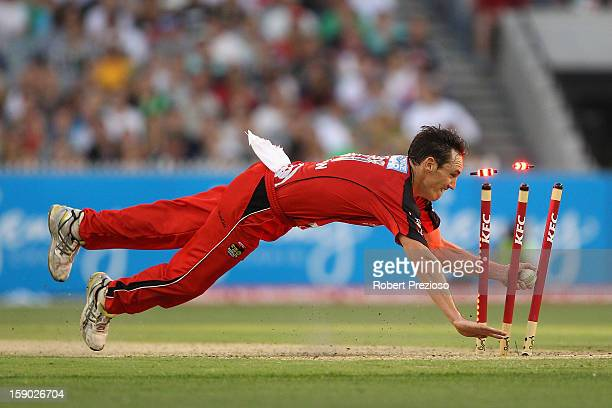 William Sheridan of the Renegades runs out John Hastings of the Stars during the Big Bash League match between the Melbourne Stars and the Melbourne...